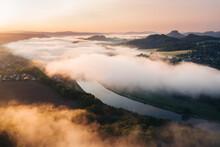 A Serene Sunrise Above The River.
