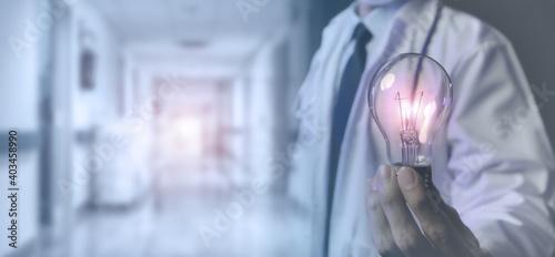 healthcare in medical technology concept, medicine doctor hold the light bulb in Fotobehang