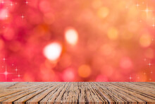 Abstract Blur Beautiful Red Color Background With Star Glitter Bokeh Light And Perspective Wood To Show, Promote And Ads Deign On Display For  Happy Chinese New Year Season Design Concept