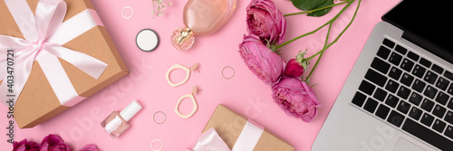 Obraz Banner with gift, laptop, flowers, feminine cosmetics and accessories on a pink background. Online celebrate or shopping concept. - fototapety do salonu