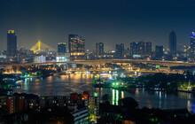 Night View Of Bangkok City And Bangkok Bridge Over Chao Phraya River