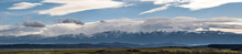 Panoramic View Of The Snow Covered Fagaras Mountains, Part Of The Carpathian Mountains.