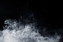 Abstract White Smoke Moves On Black Background. Swirling Smoke.