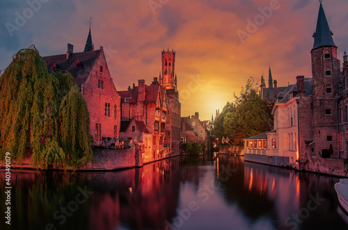 View of sunset over Bruges old town and Belfry tower at night, Bruges, Belgium Fototapeta
