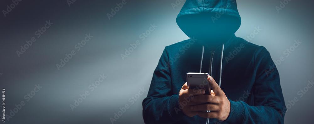 Fototapeta the hacker holding smart phone