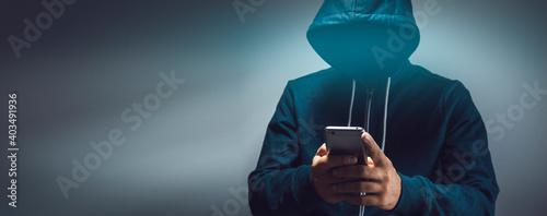 Obraz na plátně the hacker holding smart phone