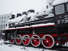 Retro Train. Locomotive Of The 19th Early 20th Century With A Steam Engine. Vintage Style. Black Train With Red Wheels. Metal Cast Iron Parts. Levers, Engines, Fences, Boilers, Pipes Of The Train.