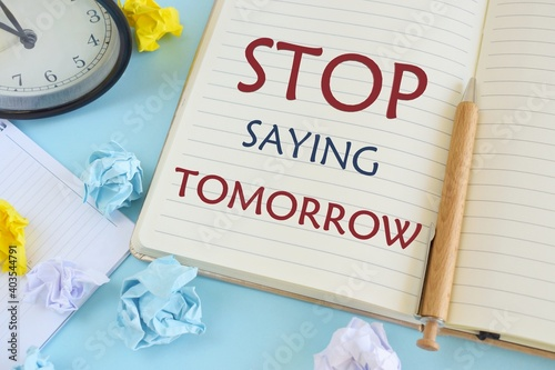 Fototapeta Stop Saying Tomorrow words written on notebook. Concept meaning way of encouraging you to act now. Business photo showcasing be urgent in your decision to take action. obraz