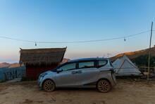 NAN, THAILAND – DECEMBER 26 2020: Drive The Mountain Any Way You Want By Toyota Sienta Mini MPV Van. On Doi Samer Dao Sri Nan National Park Location : Sri Nan National Park ,Na Noi District, Nan
