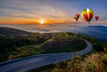 Colorful Hot-air Balloons Flying Over The Mountain And Sea Of Mist, Doi Inthanon Natural Park Chiang Mai, Thailand