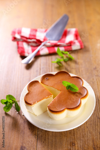 Fotografie, Obraz cheesecake on wood background- top view