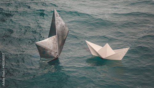 metal boat sinks while paper boat sails on the water.