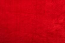 Red Artificial Fur Or Plush Plaid Surface. Faux Fur Background Of Purple Color.