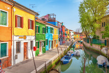 Burano Island In Venice (Venezia), Italy. Small Colorful Traditional Houses Along The Canal