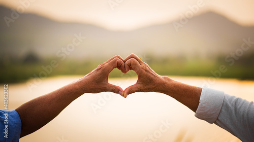 Love and Valentine day concept. A happy senior couple showing heart sign, love symbol, happy marriage, Senior healthcare and relationship.
