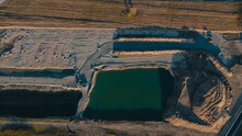 Aerial View On Open Pit Mine Of Sand, Hummus And Coal, Flooded With Water