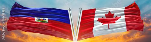 Fotografia, Obraz Double Flag Canada vs Haiti flag waving flag with texture sky clouds and sunset
