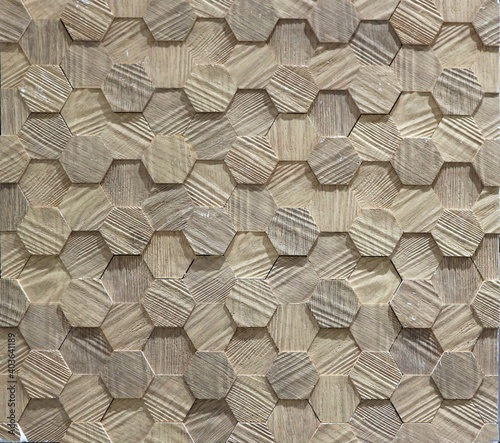 Foto Wood effect stoneware wall panel in the shape of embossed hexagons