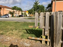 Old Rustic, Broken Wooden Fence Gate Planks For Security In Private Miami Dade County Suburban Neighboorhood Community Street