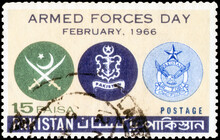 Postage Stamp Issued In The Pakistan With The Image Of The Army, Navy And Air Force Crests. From The Series On Armed Forces Day, Circa 1966