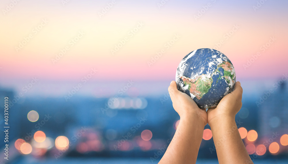 Fototapeta Donation for Covid 19 concept:  Human hands holding earth global over blurred city night background. Elements of this image furnished by NASA