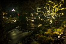Famous Columbia Gorge Hotel At Night In Christmas Decorations. Lights Reflect In Water Stream