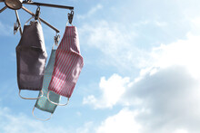 Face Masks Hanging For Reuse With Sky Background.