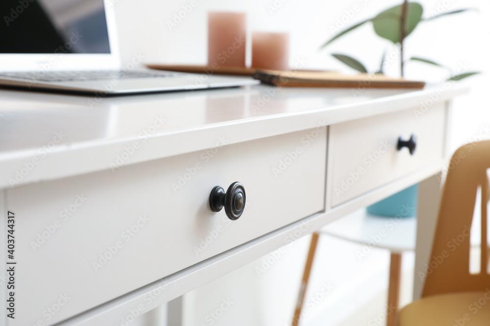 Fototapeta Table with modern laptop in room
