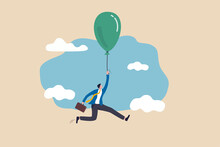 Financial Bubble By QE Injected Money Concept, Businessman Investor Holding Flying Balloon Tight Afraid To Fall Off.