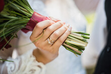 The Bride Holds A Beautiful Bouquet Of Flowers