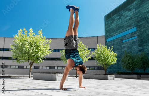 fitness, sport, training and lifestyle concept - young man exercising and doing Fototapeta