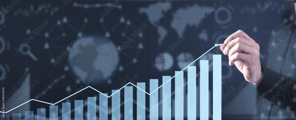 Fototapeta Man draws graph. Concept of financial growth