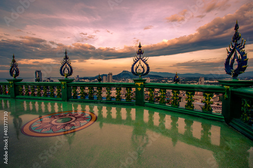 Background of Thailand's Chonburi religious attractions (Wat Khao Phra Khru viewpoint), with beautiful Buddha and Phaya Naga statues, tourists always come to make merit and take pictures at night.
