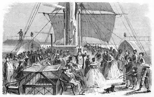 Fotografiet musicians and passengers crowd making noise on the deck of British vessel Tyne, front view displayed