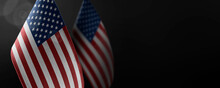 Small National Flags Of The United States On A Dark Background