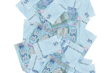 5 Ukrainian Hryvnias Bills Flying Down Isolated On White. Many Banknotes Falling With White Copyspace On Left And Right Side