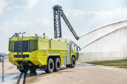 Yellow fire truck on the airport runway Fototapet