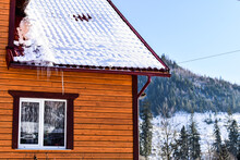 Winter Landscape, Icicles On The Roof Of The House