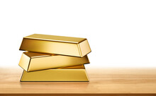Three Gold Ingots Stack Isolate Is On Wooden Table Top