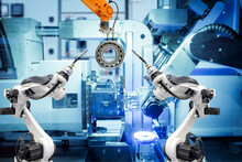 Industrial Welding Robot And Gripping Robot Working With Metal Parts On Smart Factory, On Machine Blue Tone Color Background, Industry 4.0 And AI, Automation Robotic Work Instead On Human Concept