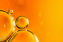 Oil Drops On Water On An Orange Background