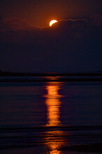 Harvest Moon Rises Over Clouds Creating Highlights On Atlantic Waters