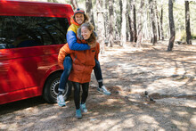 Couple Having Fun Outside A Campervan On The Forest