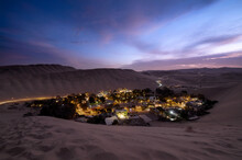 Oasis Huacachina At Dusk, Very Close From Ica, Among Sand Dunes