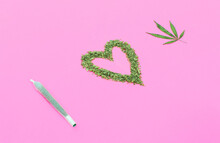 "Phrase ""I Love Weed"" Made With Marijuana On Pink Background."
