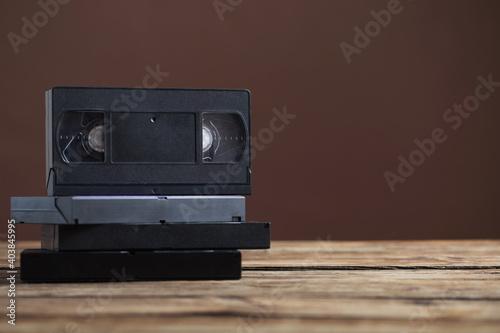Billede på lærred videotape on old wooden table