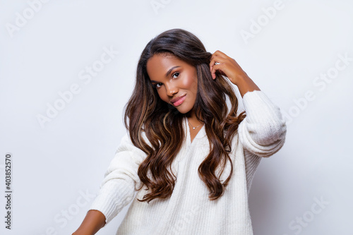 Fototapeta Happy Black Girl Smile in White Wool Sweater with long curly hair