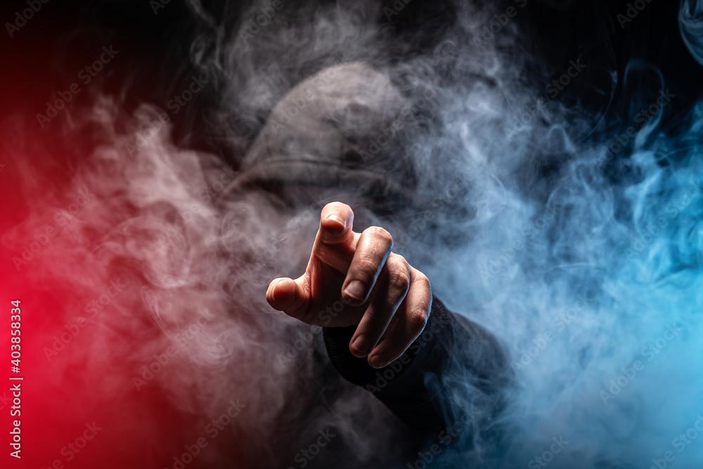 Fototapeta Hacker in a smoke-filled background