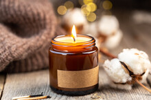 Burning Candle In A Glass Jar With Label Mock Up