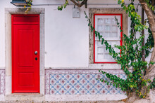 .Colorful Wooden Traditional Red Doors In Lisbon, Portugal.